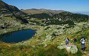 Walkers hiking along a track in the Rila mountains in Bulgaria