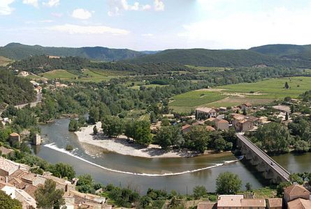 Beautiful river valley with settlement and bridge in the Languedoc