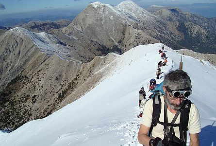 Walking holiday group preparing for ascent through snow in Greece