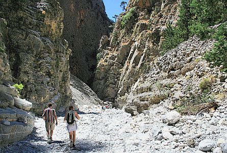 Deep rocky gorge with two walkers