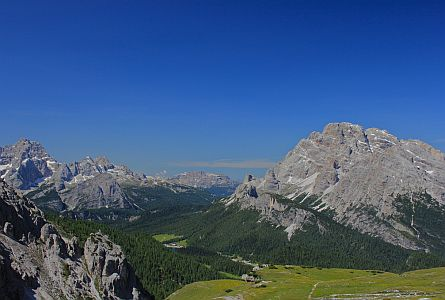 green meadows and rocky rounded peaks in the Dolomites