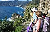 Small group of walkers looking out over the Mediterranena Sea in Liguria, Italy.