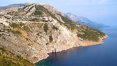 View on high sparsely vegetated mountains along the Adriatic coast. Original photo http://commons.wikimedia.org/wiki/File:Dalmatia_coast.jpg.