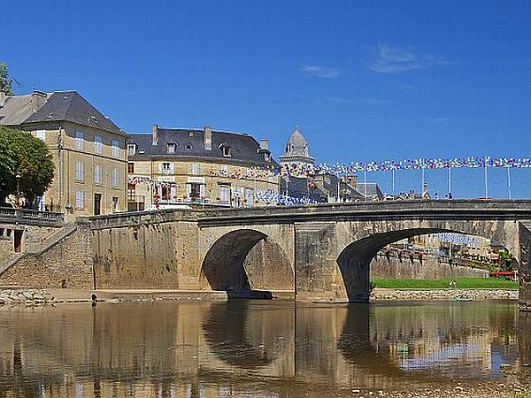 Stone bridge in riverside town in the Dordogne