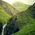 Waterfall coming down rolling hills, see this during your walking holidays in Europe