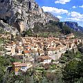 A small village against a mountainside in the Provence, France.