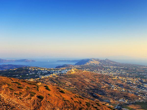 wide view on landscape of Santorini in golden early morning light