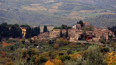 View on a small medieval town in an autumn landscape in Tuscany.