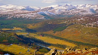 View on the Cairngorms mountains in Scotland with the river Dee in the valley below. Original photo by Alan Findlay  (see  http://commons.wikimedia.org/wiki/File:The_Cairngorms_-_geograph.org.uk_-_1766434.jpg)