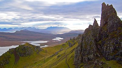 View on rugged mountain landscape with Scottish lochs and the Cuillin mountains in the distance.