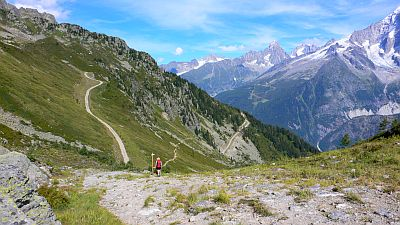 Woman walking through mountains in France. Original photo by Heatheronhertravels (see http://www.flickr.com/photos/heatheronhertravels/4968090659)
