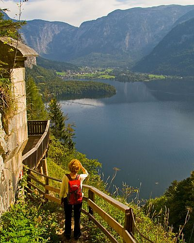 Woman walking a track looking out over Lake Hallstatt in Austria's pre-Alps. Original photo by Richard Taylor (see http://www.flickr.com/photos/34094515@N00/406226275/)