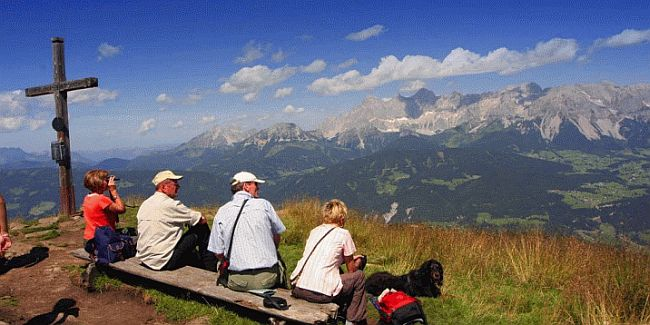 Walkers enjoying a break during a walking holiday in the Dachstein mountains in Austria
