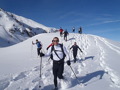 group of people snowshoeing in the French Alps