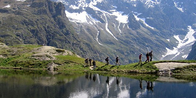 Walkers at Lac du Lauzon in the French Alps