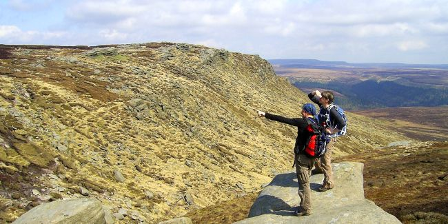 Pair of walkers on a rocky outcrop.