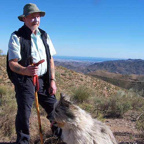 A man walking with his dog in Spain.