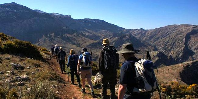 Group of people walking in the Andalucian mountains.