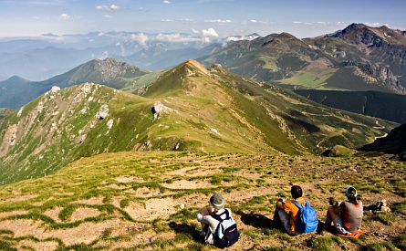 Walkers enjoying view in Picos de Europa mountain range in Spain