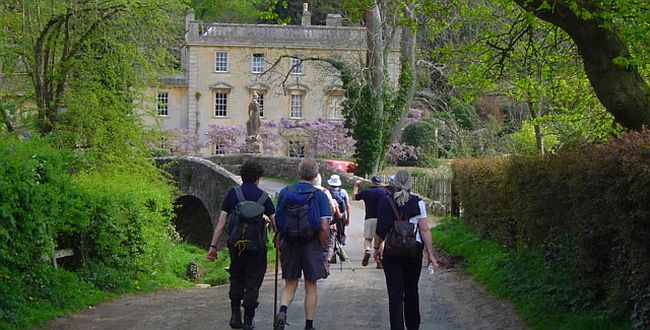 Group of people walking in Somerset. approaching a castle