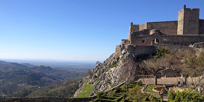 Hilltop castle overlooking a rural landscape in the Portugese Alentejo
