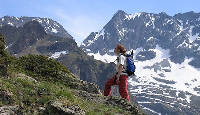 a walker enjoying panoramic views in the Alps