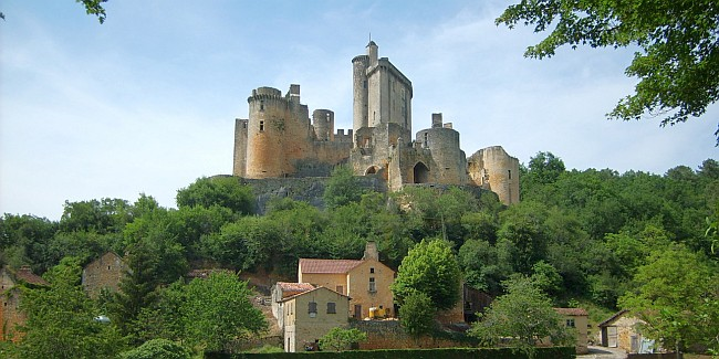 Hilltop castle overlooking a rural landscape in the Lot Valley in France