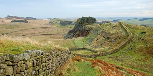 Walkers along a section of Hadrian's Wall in England