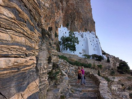 Walkers on stairs made from rocks leading towards the 1000 year old Byzantine Chozoviotissa Monastery on Amorgos
