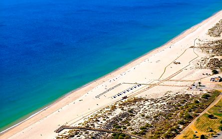 Aerial photo of Manta Rota Beach in the Algarve - golden sand with a deep blue sea
