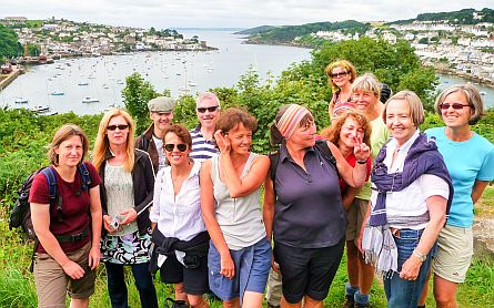 Walkers in front of Polruan and Fowey in Cornwall
