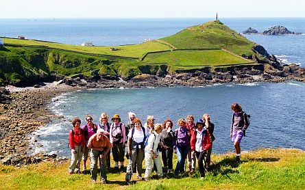 Group of walkers in front of a bay at Cape Cornwall