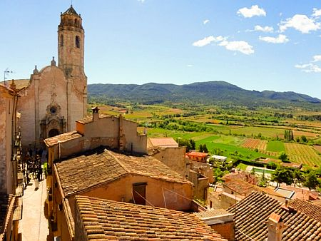 View over rooftops towards the church of the village of Barbera