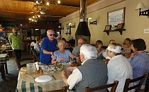 People sitting around a big table in a restaurant