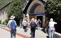 People walking in a monastery