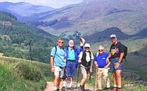 Group of walkers posing in front of mountains in the English Lakeland.