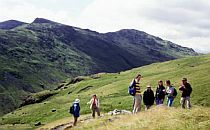 Group of people on a walk in the low mountains of the Lake District.
