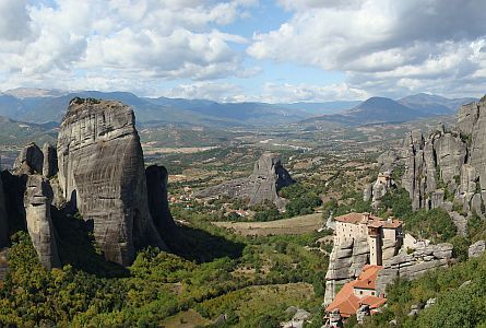 stunning landscape with large rock outcrops and monastery around Meteora in Greece
