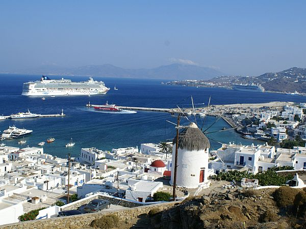 whitewashed houses, mill and harbour in Mykonos