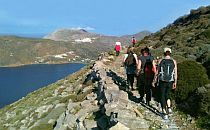group on a walking holiday on Amorgos walking along a steep coastal path