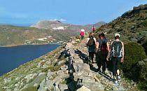 group on a walking holiday on Amorgos walking along a steep coastal path
