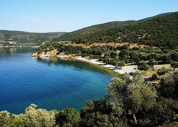 Settlement and beach along wooded coast in Greece