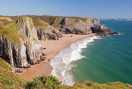 sandy beach and steep cliffs along the Pembrokeshire coast