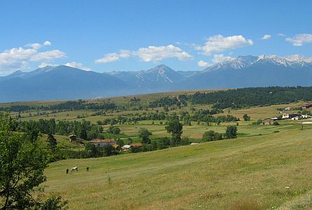 rural landscape with high mountains in the background in the Pirin region in Bulgaria