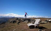 Person balancing on a rocky hilltop