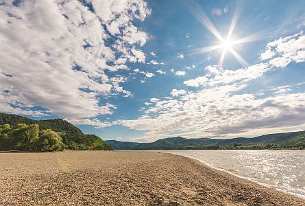 view on sandy beach along the danube river