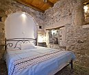 Bedroom with natural stone walls