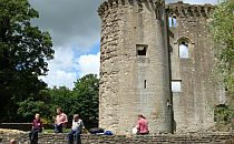 walkers enjoying a break near a castle in Somerset