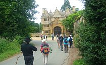 People walking towards an ancient building in Cotswolds, England