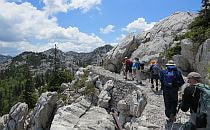People walking on a trail in the mountain